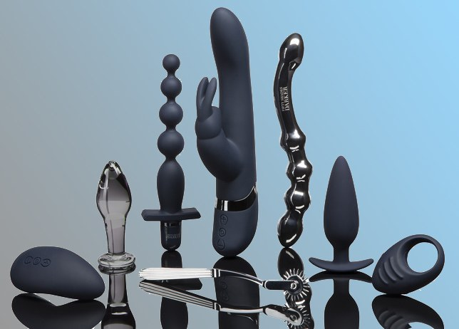 Collection of various sex toys, blue background