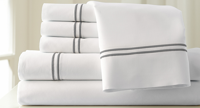 Pile Of Folded White Bed Linens