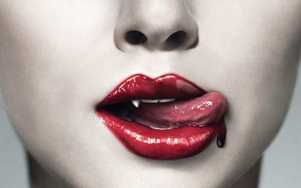 Vampire fetish, blood dripping from red vampire lips